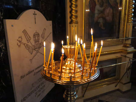 Candles burning in interior of a orthodox church