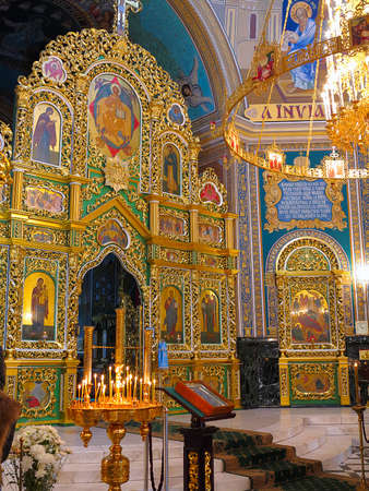 Gold ornated interior of orthodox church in Europe