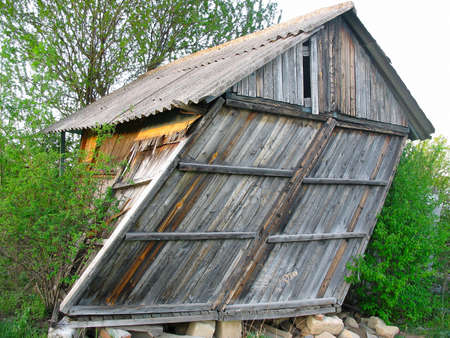 Abandoned cabin old wooden house small curved hut photo