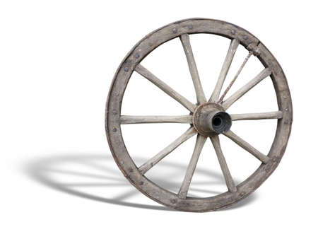 Antique Cart Wheel made of wood and iron-lined, with shadow over white Stock Photo - 17670696