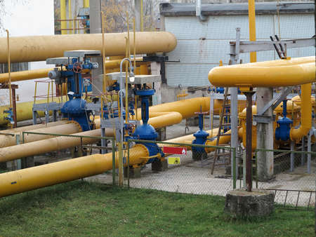 water power plant: Natural gas station with yellow pipes at power plant