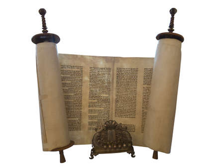 judaism: The Jewish Torah scroll and a gold menorah candle support isolated over white