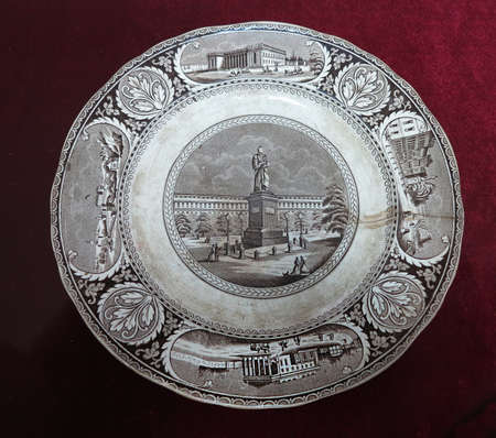 19th century: 19th Century vintage old plate with paintings isolated over white background Stock Photo