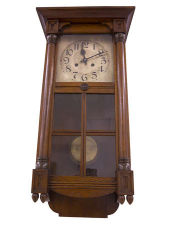 19th Century old pendulum wooden clock isolated on the white  photo