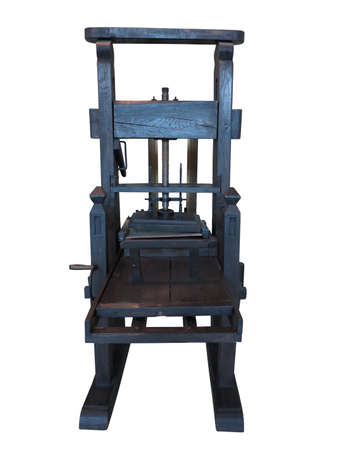 Vintage old black letterpress restored to working condition, isolated on white background photo