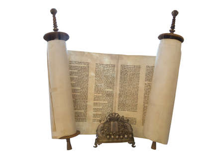scripture: The Jewish Torah scroll and a gold menorah candle support isolated over white