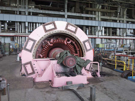 voltage gray: Electric power generator and steam turbine during repair at power plant Stock Photo