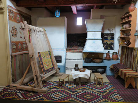 hand woven: Ancient wooden vintage loom producing handmade carpet