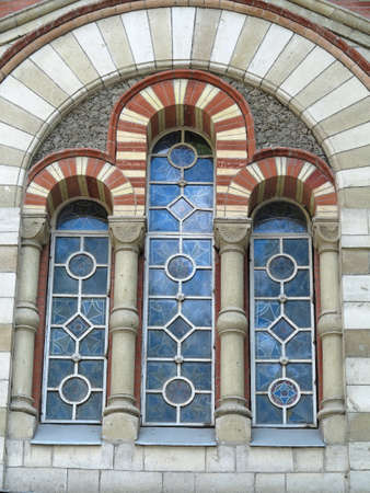 church window: Ancient tall gothic stained glass window in the medieval church Stock Photo