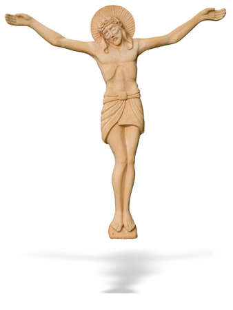 Wooden statue of The crucified Jesus Christ isolated over white background photo