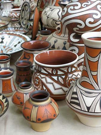 Colorful designed clay pottery ceramic vases on market photo