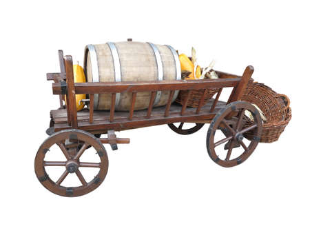 Vintage wooden cart with wine barrel, wicked basket and pumpkin isolated over white background photo