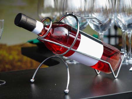 aligote: White empty label wine bottle in metallic support