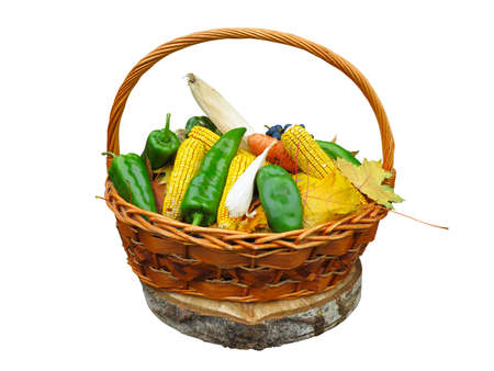 weaker: Corn vegetables and yellow leaves in basket isolated on white background Stock Photo
