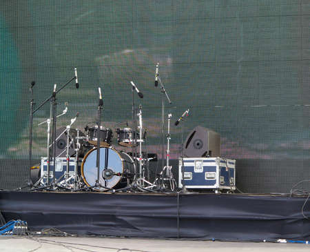 powerfull: Drums set, powerfull speakers, amplifiers and equipment on stage Stock Photo