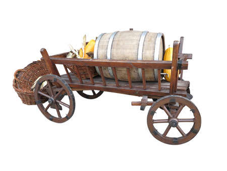 barell: Vintage wooden cart with wine barrel, wicked basket and pumpkin isolated over white background