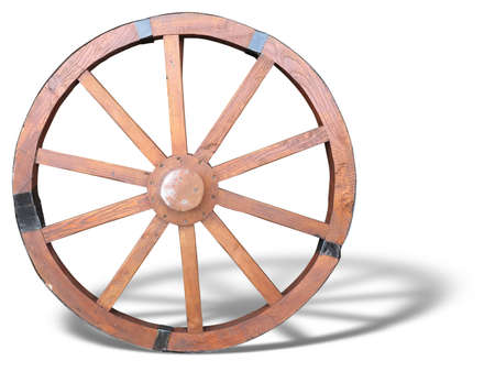 wagon: Antique Cart Wheel made of wood and iron-lined with shadow isolated over white