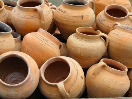 Red clay pottery ceramic vases abstract background photo