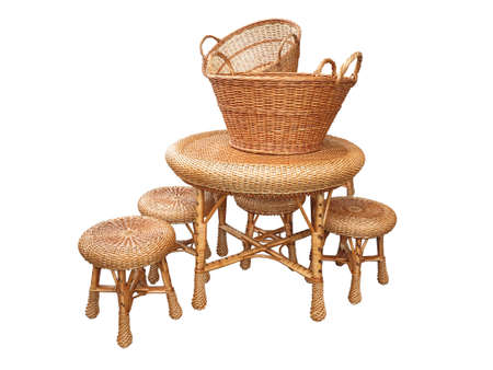 Wicker furniture - table, chair and baskets isolated on white background  photo