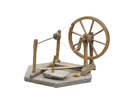spinning wheel: Old manual wooden spinning-wheel distaff isolated on white background Stock Photo