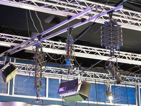 Television studio light equipment, spotlight truss, cables,  microphones and so on Stock Photo