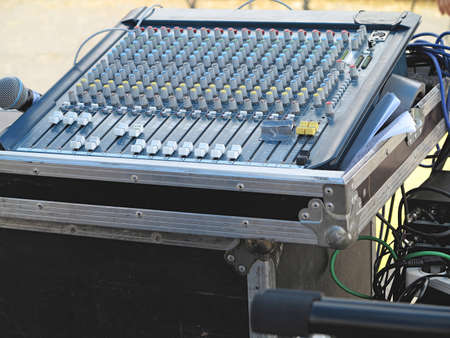 Closeup of the sound mixer control console. photo