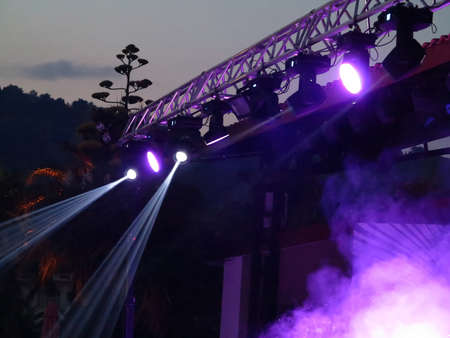 Abstract blue bright spotlights in open air stage theater Stock Photo