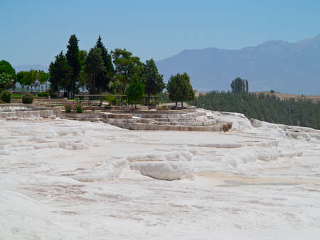 basin mountain: Famous landmark white calcium travertines and pools as a heritage geological landscape in Turkey, Pamukkale. Pamukkale means cotton castle.