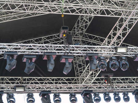 Structures of stage illumination elements spotlights equipment and speakers photo