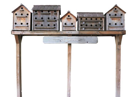 Old wooden starling nesting boxes bird house isolated over white background photo