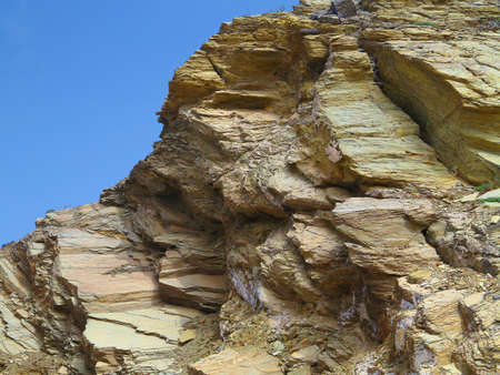 shale: Laminated structure of mountain rock over blue sky background Stock Photo