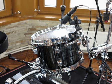 drum kit: Black drum kit, cables and microphones closeup detail