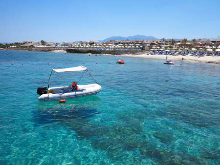 cerulean: Boat over cerulean clear water on Crete coast, Greece