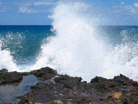 large rock: Big waves on rock coast blue sea and sky on Crete, Greece