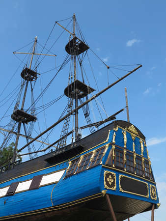 masts: Masts and rigging of a old sailing ship over blue sky
