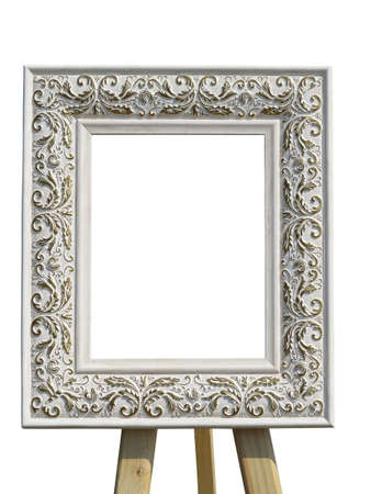 ornated: Old vintage ornate white picture frame with pattern on tripod isolated