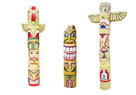 canada aboriginal: Wooden indian colorful totem pole isolated on white background Stock Photo
