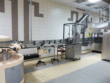 winemaking: Modern line for bottling wine in a vinery Stock Photo