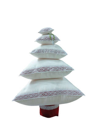 cushions: Abstract creative Christmas tree made from cushions isolated over white background.