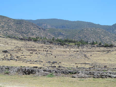 hierapolis: Ruins of the ancient city of Hierapolis and blue sky in Denizli, Turkey