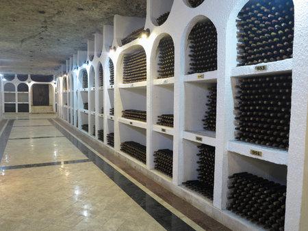 niches: 03.10.2015, CRICOVA, MOLDOVA Big underground wine cellar with collection of bottles in niches Editorial