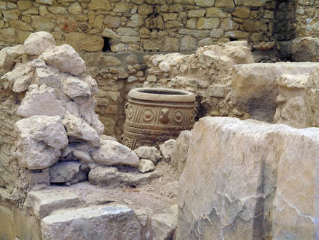 excavating: 19.06.2015, Crete, Greece. Archaeologist excavating on ancient ruins of Knossos palace.