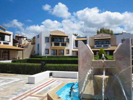 minoan: 23.06.2015, CRETE, GREECE. Luxury view of greek village on Crete in tropical minoan style architecture