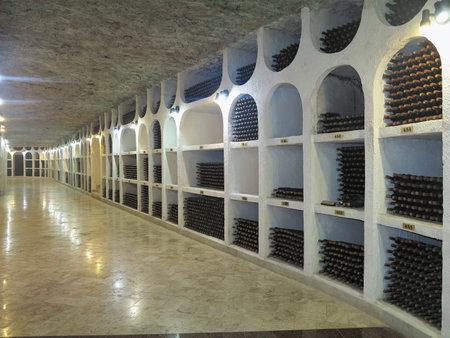 niches: 3.10.2015, Moldova, Cricova. Big underground wine cellar with collection of bottles in niches