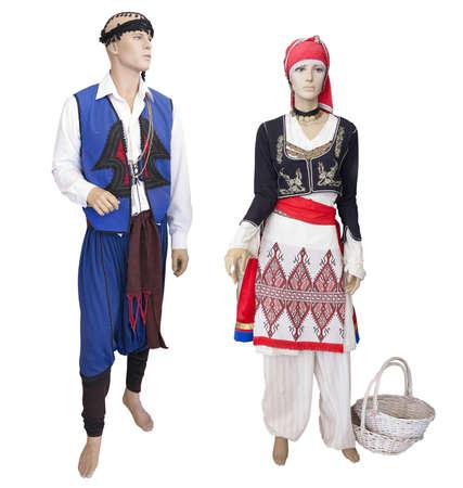 伝統: Greek cretan national man and woman clothes costume on mannequin isolated over white background