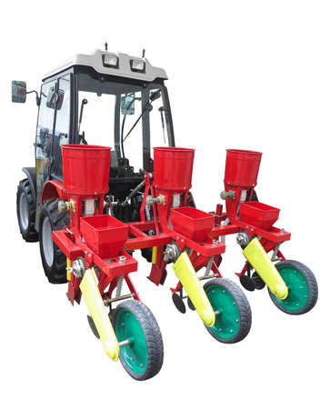 Red agricultural seeding machine on tractor isolated over white background