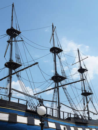 rigging: masts and rigging of a old sailing ship over blue sky background