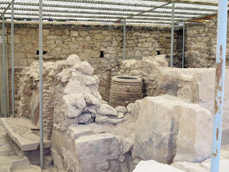 archaeologist: Crete, Greece. Archaeologist excavating on ancient ruins of Knossos palace.