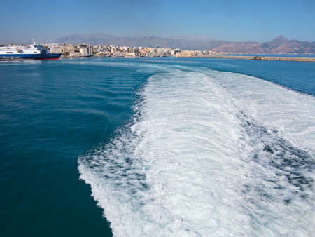 outgoing: 18.06.2015; Heraklion, Greece - View to seaport and trace of water from the outgoing ship. Editorial