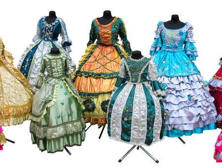male costume: Colorfull stylized woman medieval costume clothes on mannequins isolated